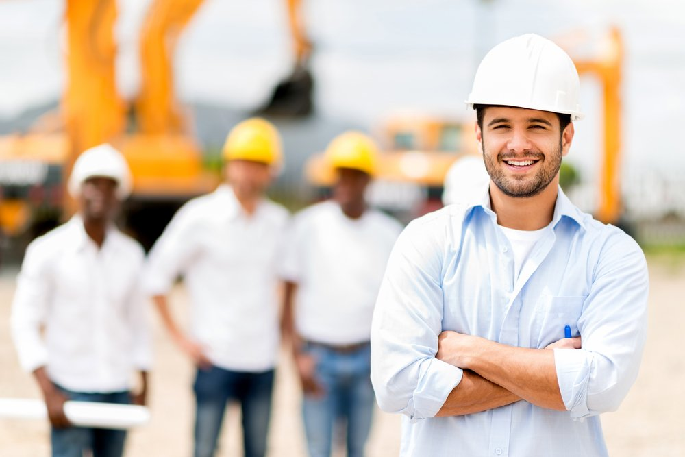 Male architect at a construction site looking happy-1